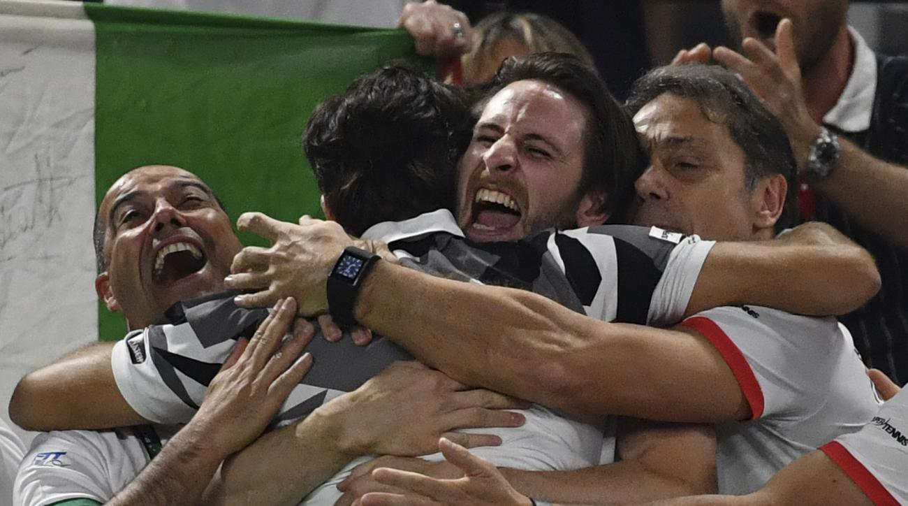 Italian team members embrace Simone Bolelli after he and Andreas Seppi beat Belgium's Ruben Bemelmans and Joris De Loore, during their Davis Cup World Group Quarterfinal match, in the Spiroudome de Charleroi stadium, in Charleroi, Belgium, Saturday, April