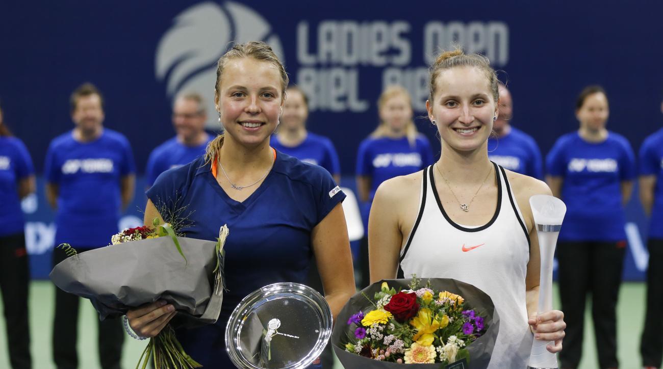 Winner Marketa Vondrousova of Czech Republic, right, and  second placed Anett Kontaveit of Estonia pose after the final match, at the WTA Ladies Open tennis tournament in Biel, Switzerland, Sunday, April 16, 2017. (Peter Klaunzer/Keystone via AP)