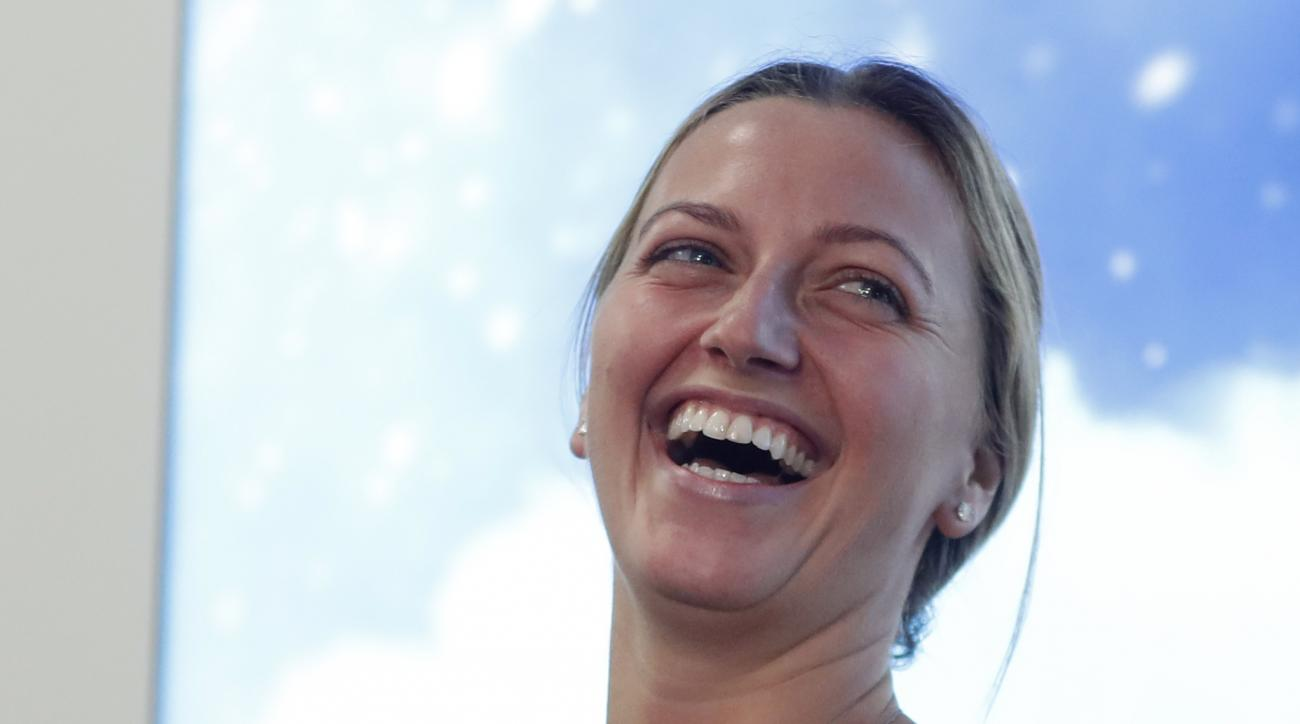 Czech Republic's tennis player Petra Kvitova smiles while holding a statement for media in Prague, Czech Republic, Friday, Dec. 23, 2016. Two-time Wimbledon champion was injured Tuesday Dec. 20, 2016 when a knife-wielding intruder attacked her at her home