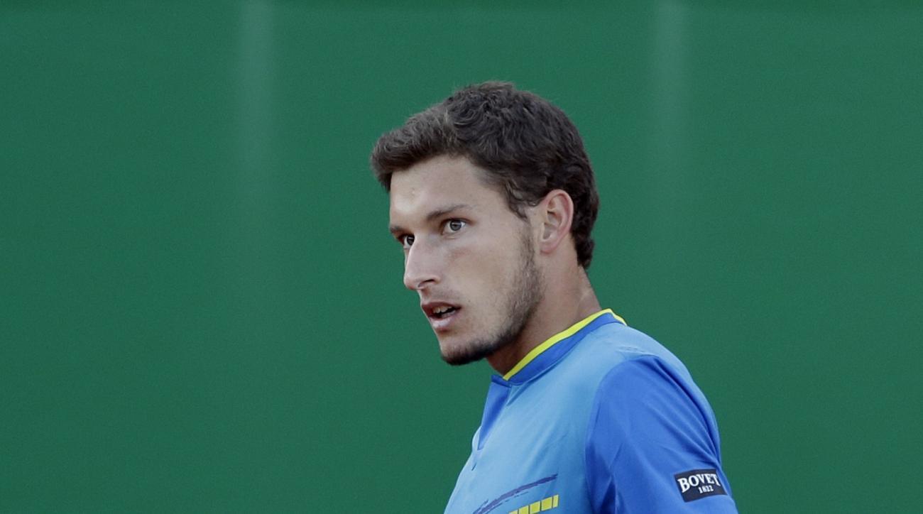 Spain's Pablo Carreno Busta reacts, during their third round match of the Monte Carlo Tennis Masters tournament against Serbia's Novak Djokovic, in Monaco, Thursday, April, 20, 2017. (AP Photo/Claude Paris)