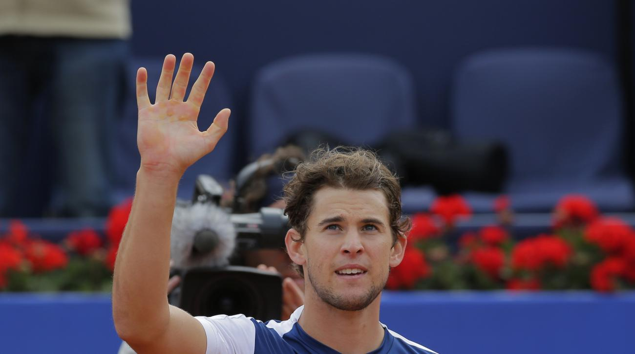 Dominic Thiem of Austria waves after defeating Andy Murray of Britain 6-2, 3-6, 6-4 during a semifinal match at the Barcelona Open Tennis Tournament in Barcelona, Spain, Saturday, April 29, 2017. (AP Photo/Manu Fernandez)