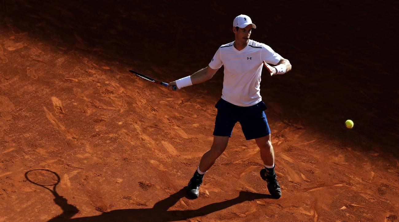 Andy Murray from Britain returns a ball to Marius Copil from Romania during a Madrid Open tennis tournament match in Madrid, Spain, Tuesday, May 9, 2017. (AP Photo/Francisco Seco)