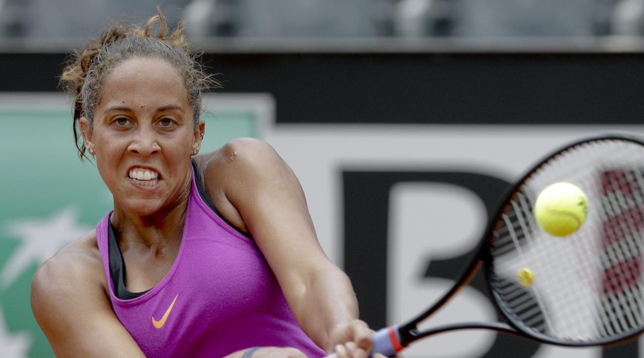 Madison Keys of the United States returns the ball to Daria Gavrilova of Australia during the Italian Open tennis tournament, in Rome, Tuesday, May 16, 2017. Gavrilova won 2-6, 7-5, 7-5. (AP Photo/Andrew Medichini)