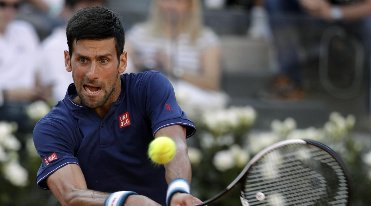 Novak Djokovic, of Serbia, returns the ball to Britain's Aljaz Bedene, during the Italian Open tennis tournament, in Rome, Tuesday, May 16, 2017. (AP Photo/Andrew Medichini)