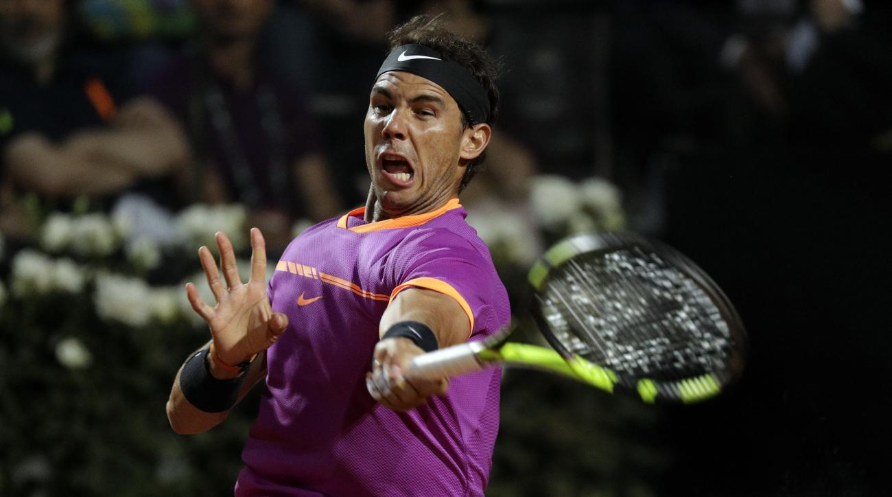 Spain's Rafael Nadal returns the ball to United States' Jack Sock during their match at the Italian Open tennis tournament, in Rome, Thursday, May 18, 2017. (AP Photo/Gregorio Borgia)