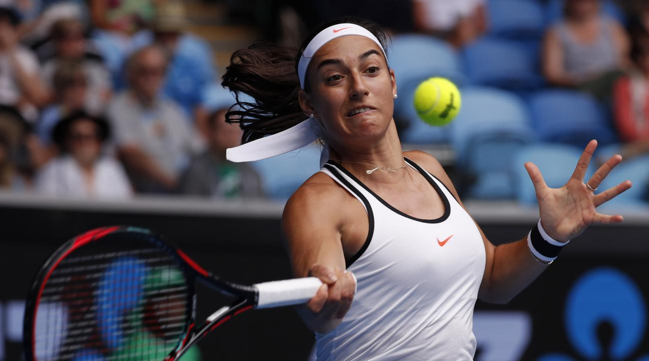 France's Caroline Garcia makes a forehand return to Barbora Strycova of the Czech Republic during their third round match at the Australian Open tennis championships in Melbourne, Australia, Saturday, Jan. 21, 2017. (AP Photo/Kin Cheung)