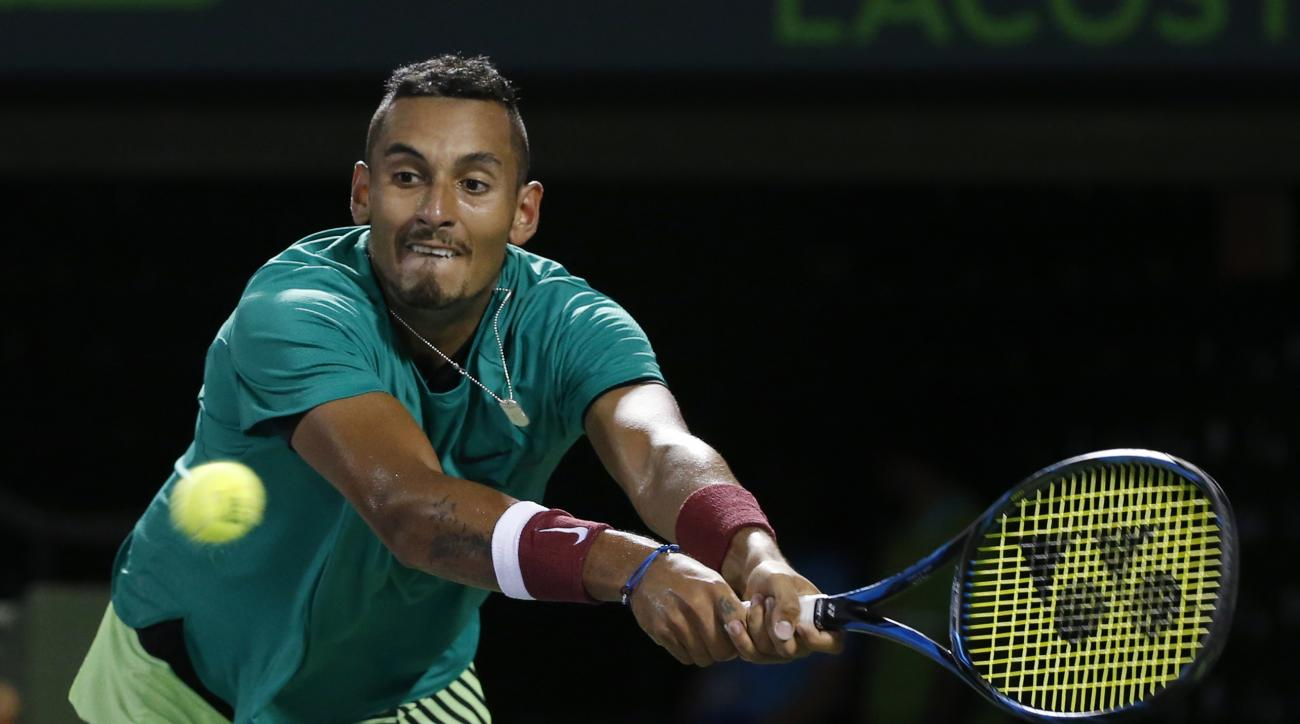 Nick Kyrgios, of Australia, returns a shot from Roger Federer, of Switzerland, during a tennis match at the Miami Open, Friday, March 31, 2017, in Key Biscayne, Fla. (AP Photo/Wilfredo Lee)