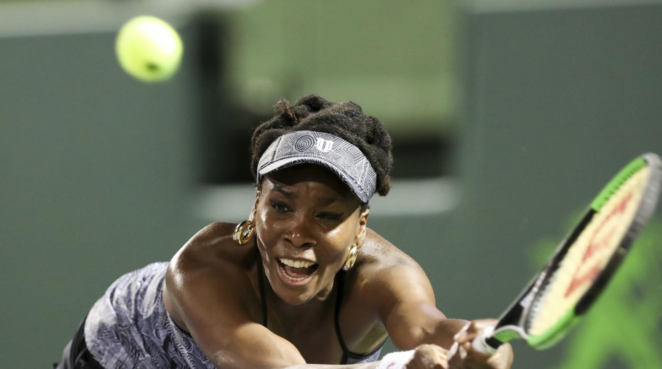 FILE - In this March 29, 2017, file photo, Venus Williams tries to return a shot against Angelique Kerber during a quarterfinal match at the Miami Open tennis tournament,  in Key Biscayne, Fla. Venus Williams will be competing in the French Open. (AP Phot