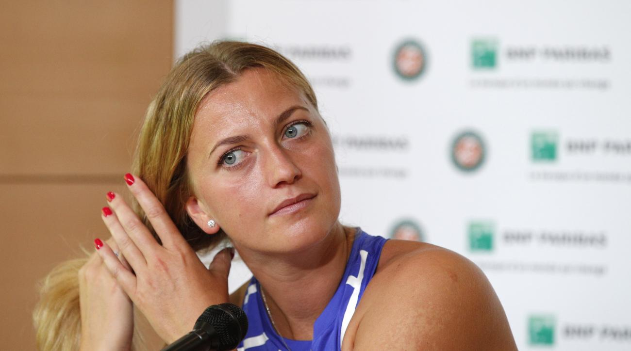 Petra Kvitova of the Czech Republic adjusts her hair during a press conference at the Roland Garros stadium, Friday, May 26, 2017 in Paris. Kvitova has confirmed she is making her comeback at the French Open, less than six months after being attacked by a