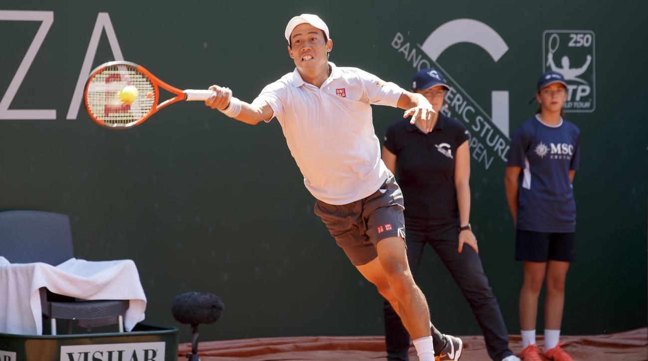 Kei Nishikori of Japan returns a ball to Mischa Zverev of Germany during their semifinal match at the Geneva Open tennis tournament, in Geneva, Switzerland, Friday, May 26, 2017. (Salvatore Di Nolfi/Keystone via AP)