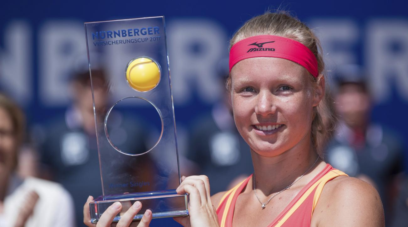 Kiki Bertens of the Netherlands poses with the trophy after defeating Czech player Barbora Krejcikova during their final match of the WTA tennis tournament in Nuremberg, Germany, Saturday, May 27, 2017. (Daniel Karmann/dpa via AP)