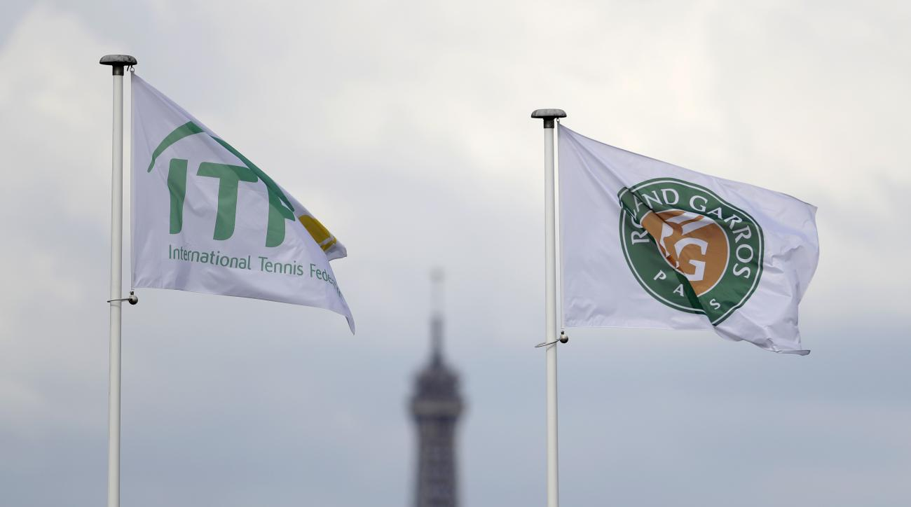 The Eiffel Tower is framed by the ITF flag and the Roland Garros stadium flag during the French Open tennis tournament at the Roland Garros stadium, Monday, May 29, 2017 in Paris. (AP Photo/Petr David Josek)