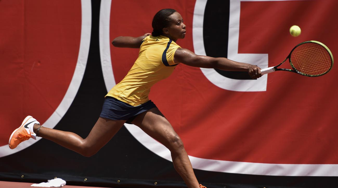 Michigan's Brienne Minor returns to Florida's Belinda Woolcock in the final match of the NCAA women's tennis championship Monday, May, 29, 2017 in Athens, Ga. Minor defeated Woolcock. (AP Photo/Richard Hamm)
