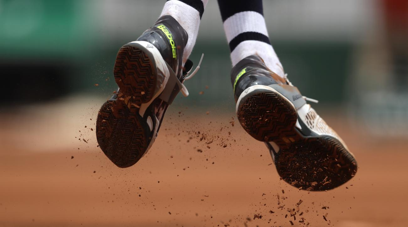France's Benoit Paire's shoes are pictured as he plays Spain's Rafael Nadal during their first round match of the French Open tennis tournament at the Roland Garros stadium, Monday, May 29, 2017 in Paris. (AP Photo/Petr David Josek)