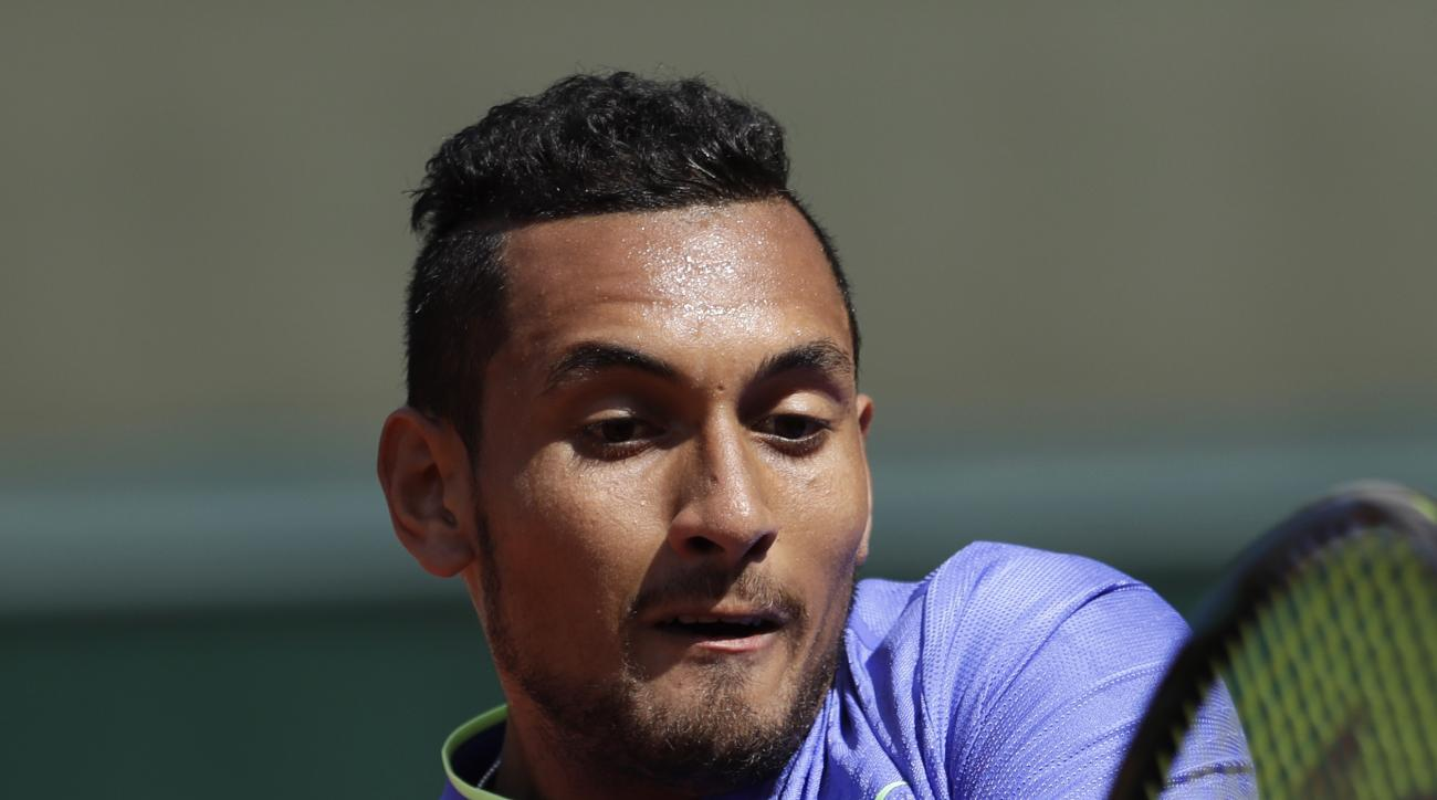 Australia's Nick Kyrgios returns the ball to Germany's Philipp Kohlschreiber during their first round match of the French Open tennis tournament at the Roland Garros stadium, Tuesday, May 30, 2017 in Paris. (AP Photo/Petr David Josek)