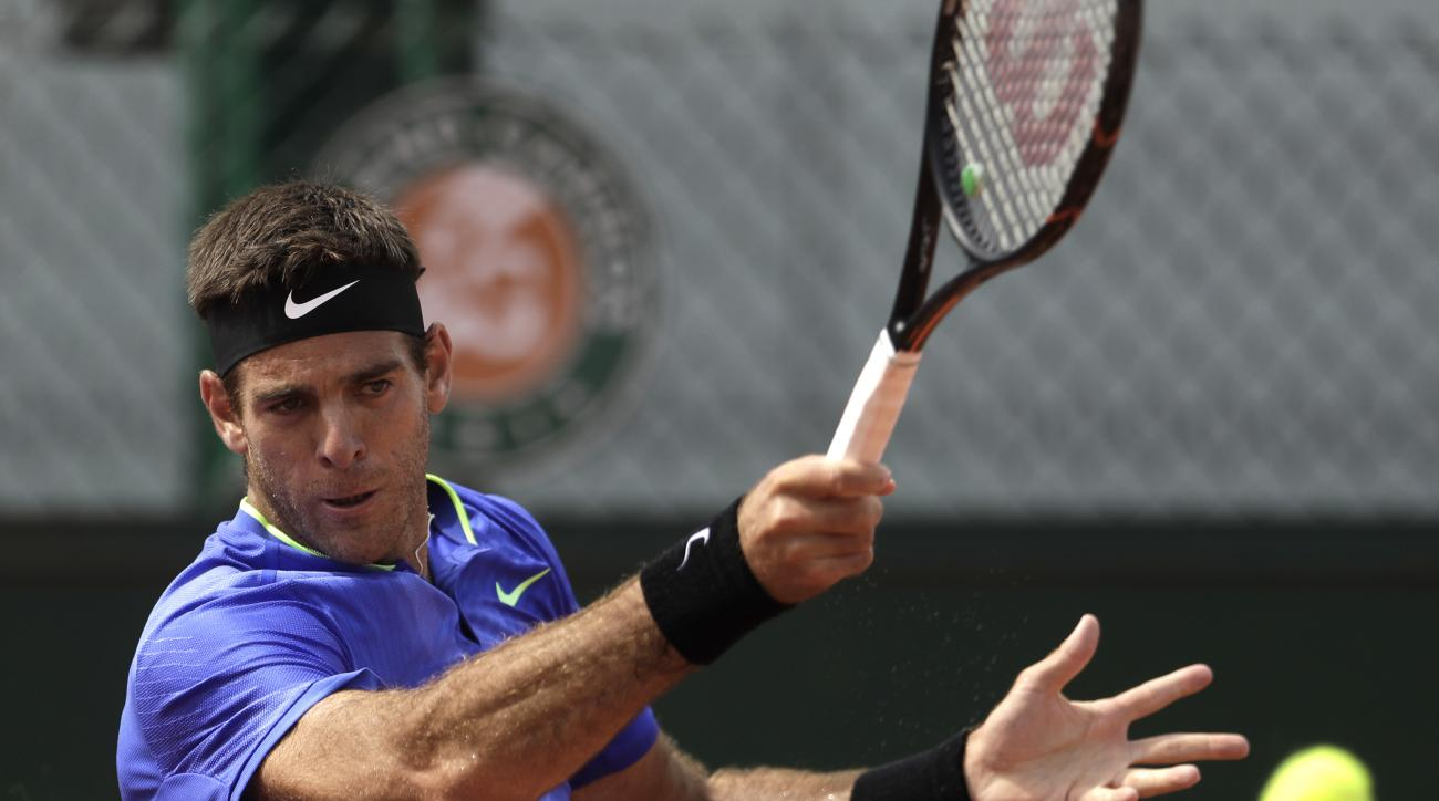 Argentina's Juan Martin Del Potro returns the ball to compatriot Guido Pella during their first round match of the French Open tennis tournament at the Roland Garros stadium, Tuesday, May 30, 2017 in Paris. (AP Photo/Petr David Josek)