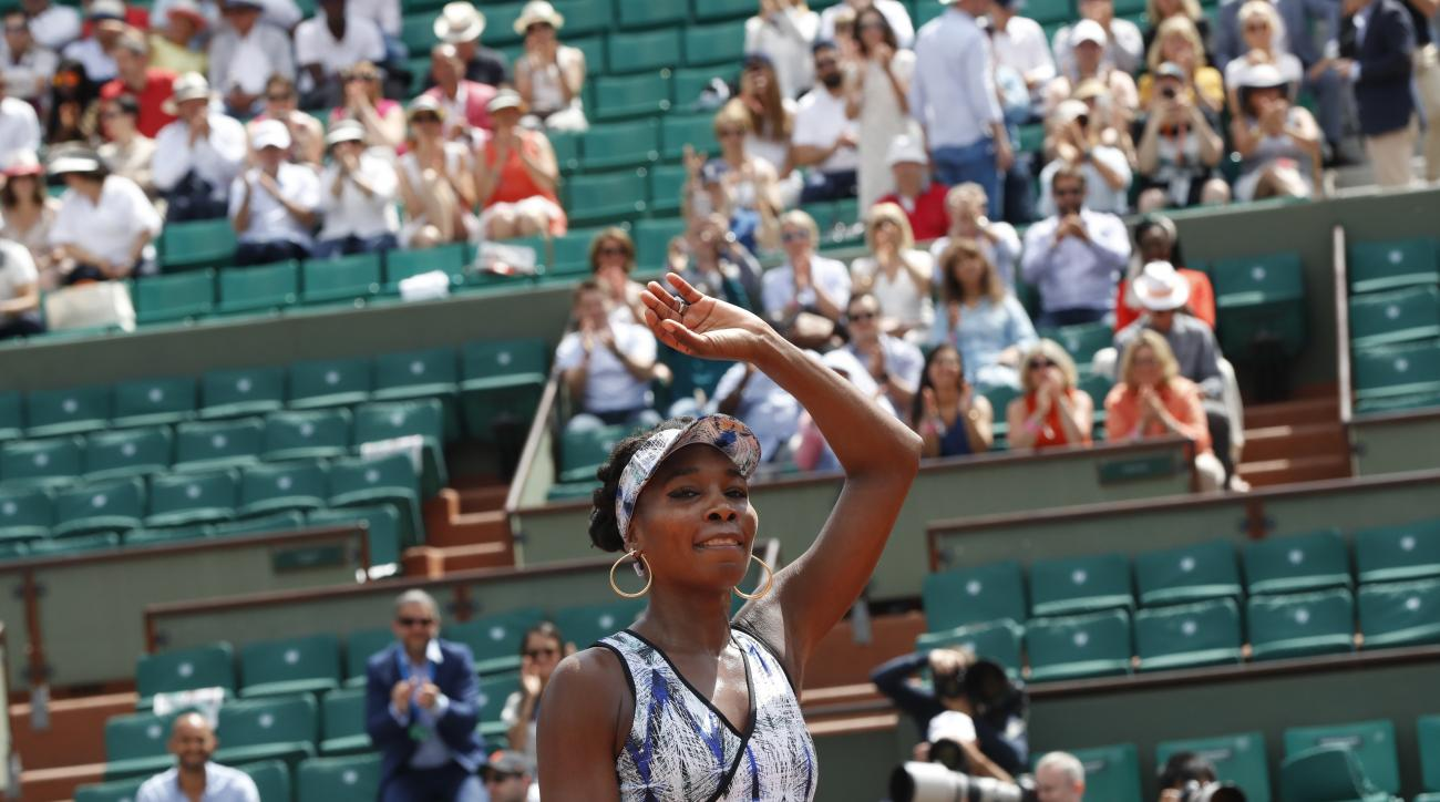 Venus Williams of the U.S. celebrates winning 6-3, 6-1, against Japan's Kurumi Nara during their second round match of the French Open tennis tournament at the Roland Garros stadium, in Paris, France. Wednesday, May 31, 2017. (AP Photo/Petr David Josek)