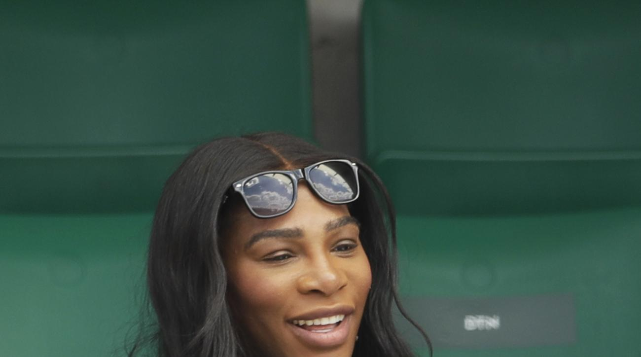 Serena Williams of the U.S., center, watches her sister Venus Williams' match against Japan's Kurumi Nara during their second round match of the French Open tennis tournament at the Roland Garros stadium, in Paris, France. Wednesday, May 31, 2017. (AP Pho