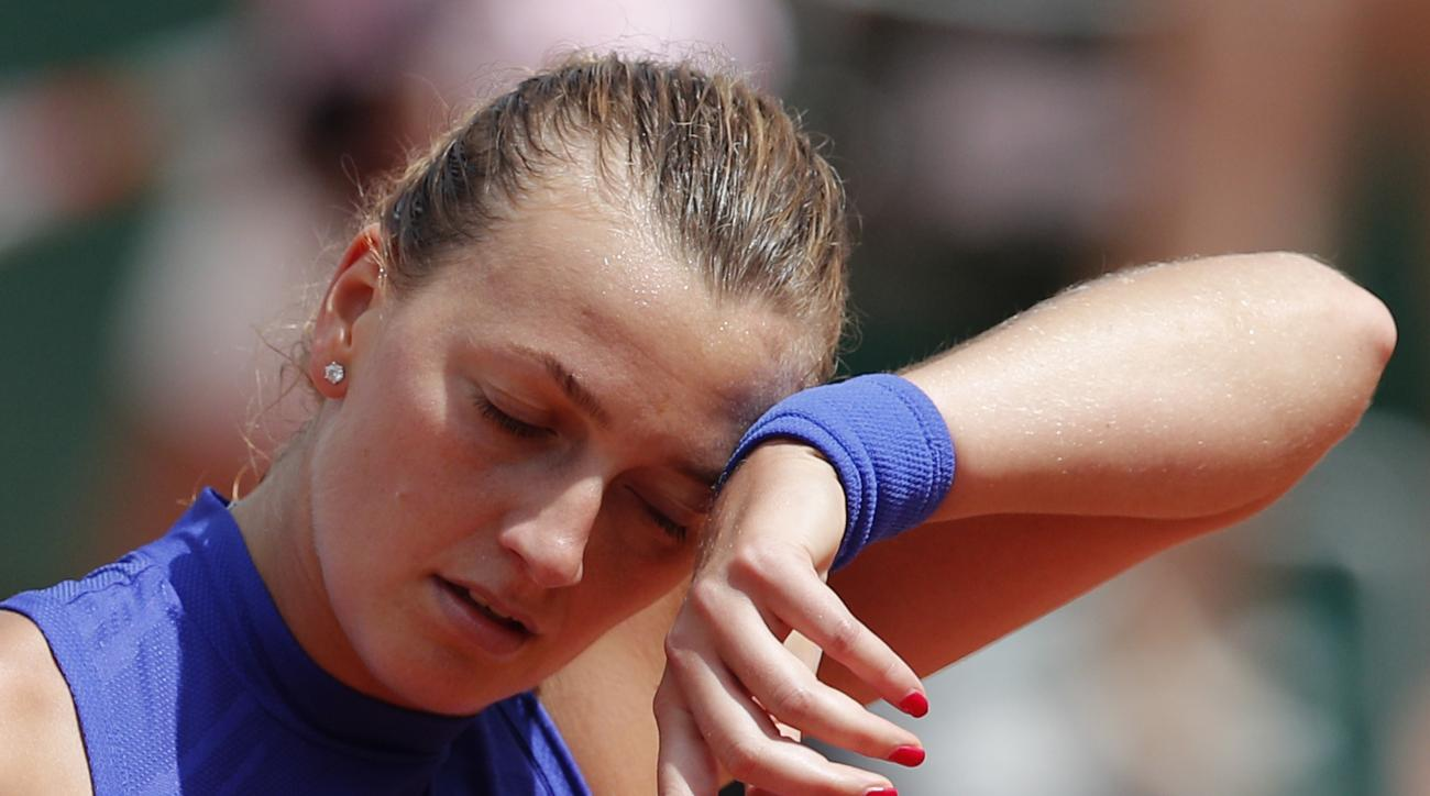 Petra Kvitova of the Czech Republic wipes the seat off her forehead in her second round match against Bethanie Mattek-Sands of the U.S. at the French Open tennis tournament at the Roland Garros stadium, in Paris, France. Wednesday, May 31, 2017. Kvitova l