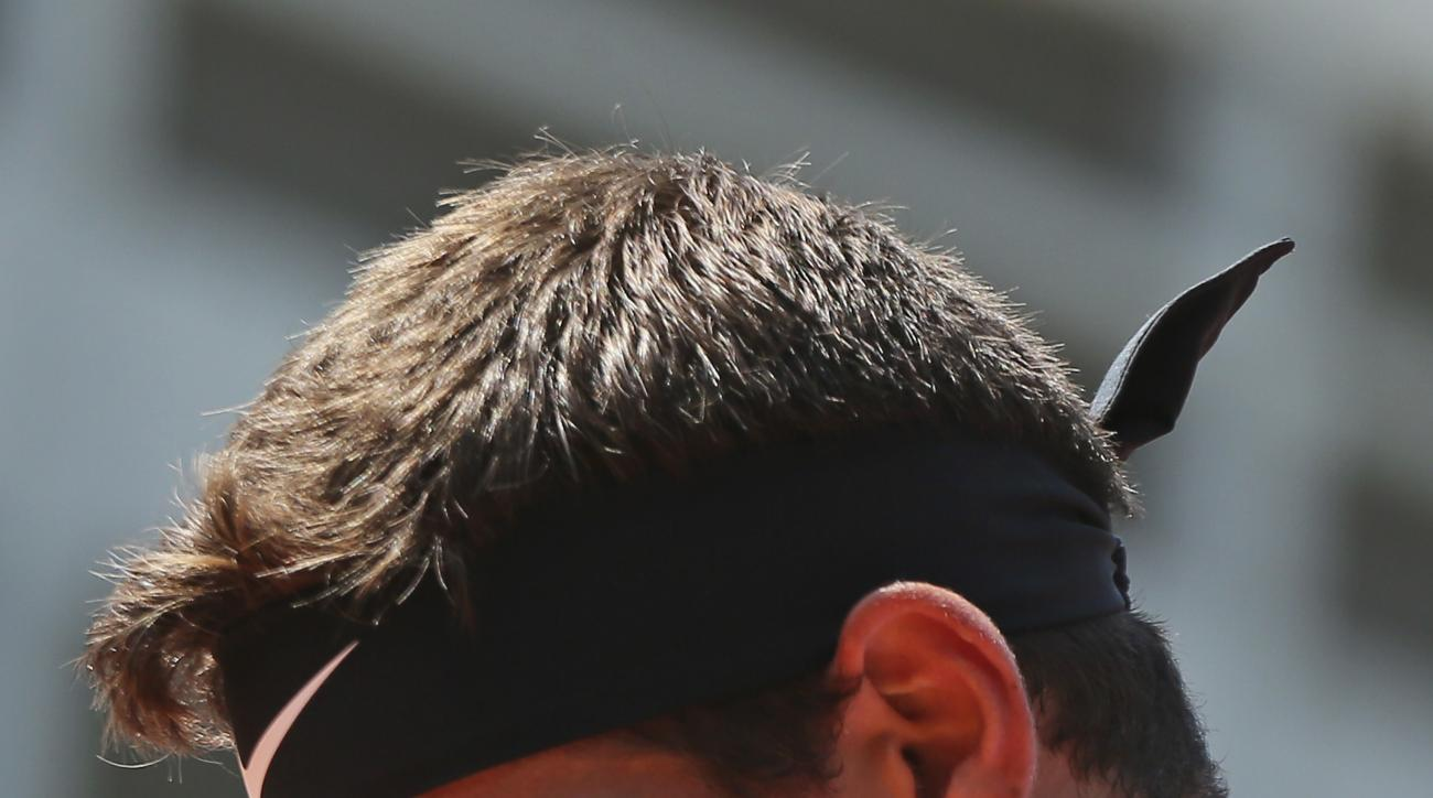 Argentina's Juan Martin del Potro reacts in his second round match against Spain's Nicolas Almagro at the French Open tennis tournament at the Roland Garros stadium, in Paris, France. Thursday, June 1, 2017. (AP Photo/David Vincent)