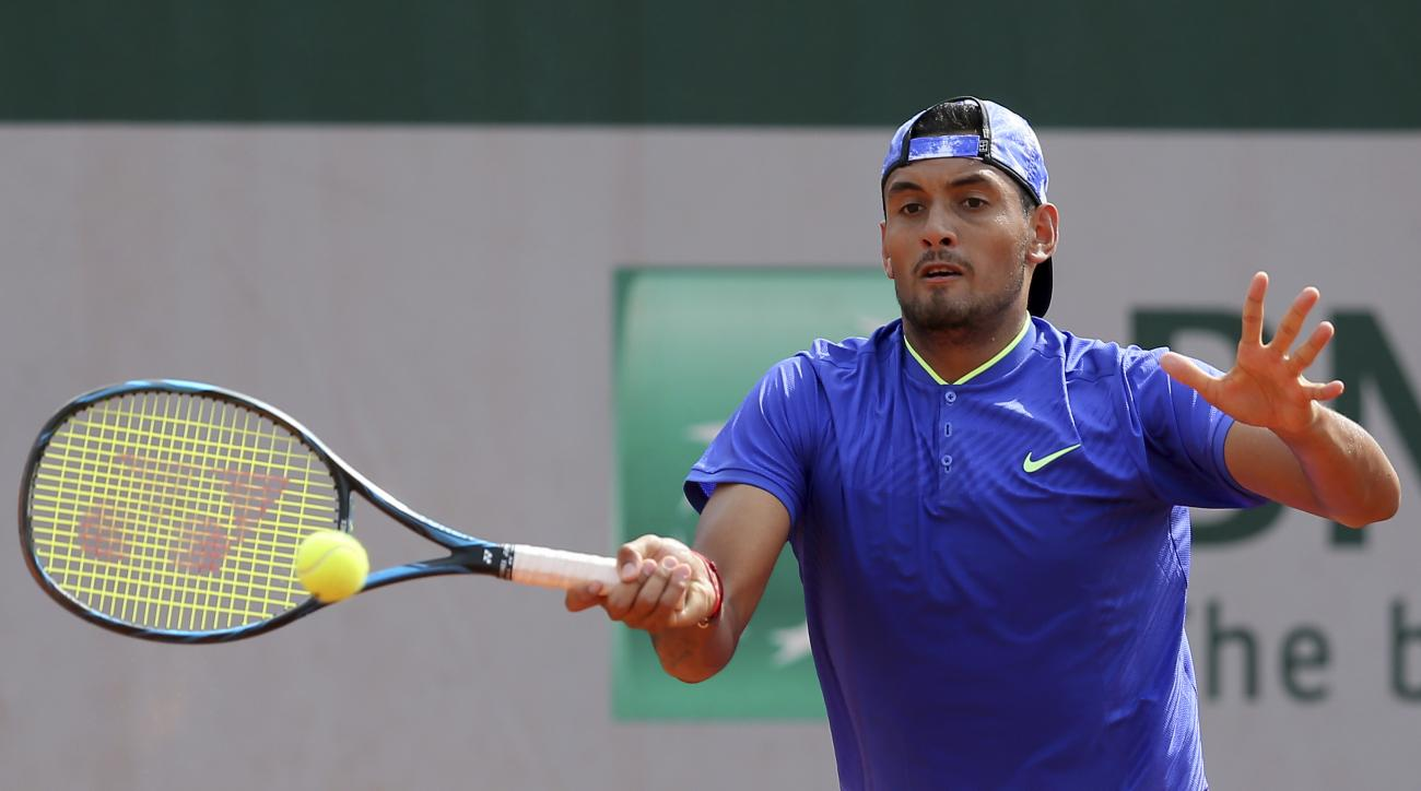 Australia's Nick Kyrgios plays a shot in his second round match against South Africa's Kevin Anderson at the French Open tennis tournament at the Roland Garros stadium, in Paris, France. Thursday, June 1, 2017. (AP Photo/David Vincent)