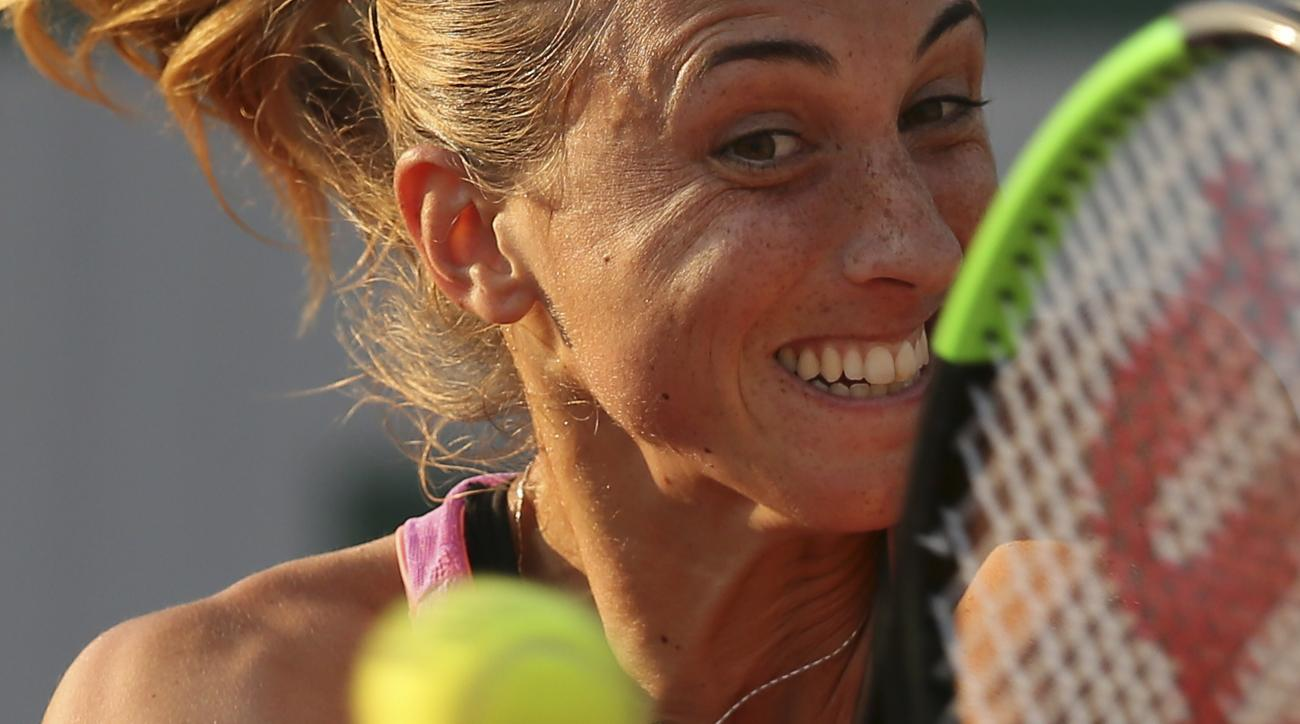 Croatia's Petra Martic plays a shot against Madison Keys of the U.S. during their second round match of the French Open tennis tournament at the Roland Garros stadium, in Paris, France. Thursday, June 1, 2017. (AP Photo/David Vincent)