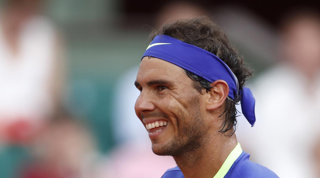 Spain's Rafael Nadal smiles after defeating Georgia's Nikoloz Basilashvili during their third round match of the French Open tennis tournament at the Roland Garros stadium, Friday, June 2, 2017 in Paris. Nadal won 6-0, 6-1, 6-0. (AP Photo/Petr David Josek