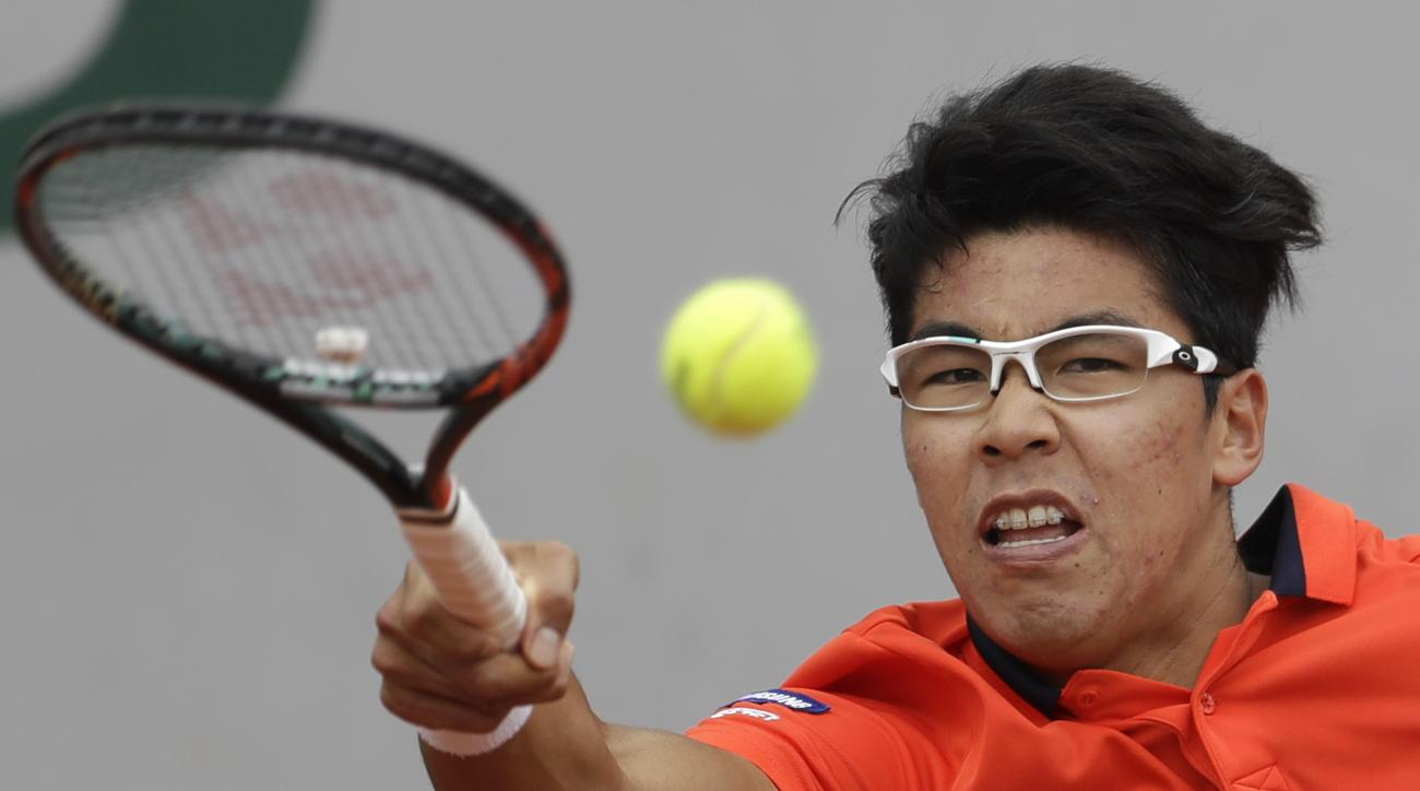 Korea's Hyeon Chung plays a shot against Japan's Kei Nishikori during their third round match of the French Open tennis tournament at the Roland Garros stadium, in Paris, France. Saturday, June 3, 2017. (AP Photo/Petr David Josek)
