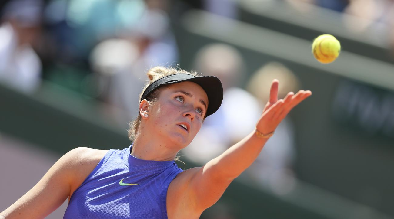 Ukraine's Elina Svitolina serves against Romania's Simona Halep during their quarterfinal match of the French Open tennis tournament at the Roland Garros stadium, in Paris, France. Wednesday, June 7, 2017. (AP Photo/David Vincent)