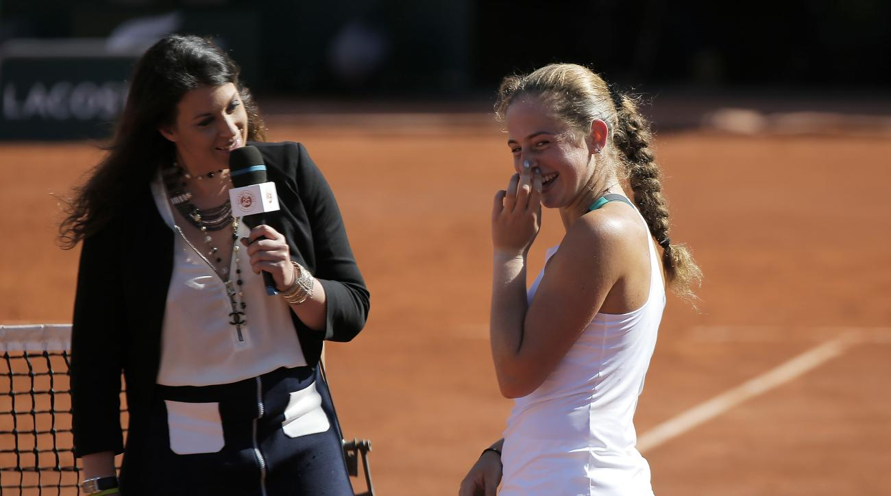Latvia's Jelena Ostapenko answers a reporter after defeating Timea Bacsinszky of Switzerland during their semifinal match of the French Open tennis tournament at the Roland Garros stadium, Thursday, June 8, 2017 in Paris. (AP Photo/Michel Euler)
