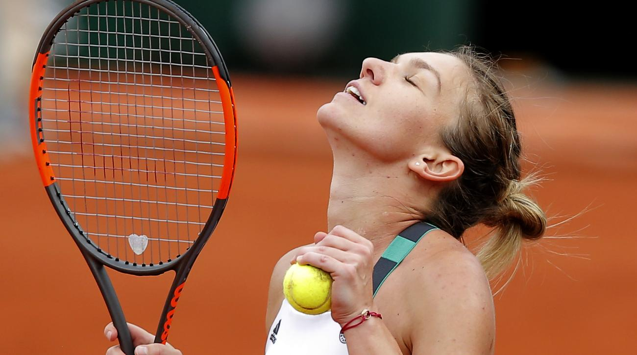 Romania's Simona Halep reacts as she defeats Karolina Pliskova of the Czech Republic during their semifinal match of the French Open tennis tournament at the Roland Garros stadium, Thursday, June 8, 2017 in Paris. (AP Photo/Michel Euler)