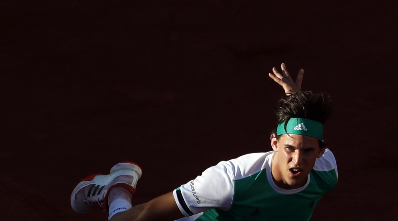 Austria's Dominic Thiem serves to Spain's Rafael Nadal during their semifinal match of the French Open tennis tournament at the Roland Garros stadium, in Paris, France, Friday, June 9, 2017. (AP Photo/Petr David Josek)