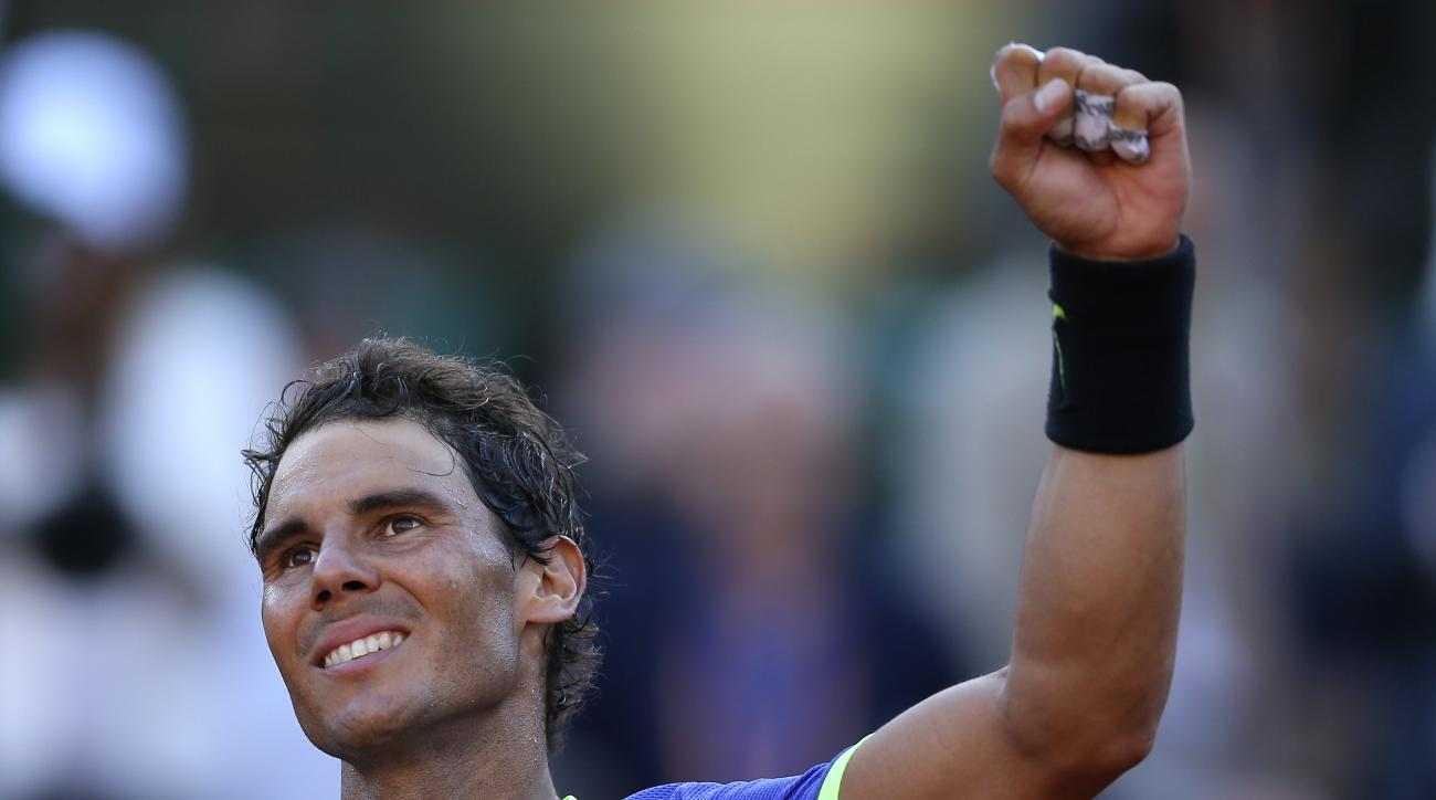 Spain's Rafael Nadal clenches his fist invictory after defeating Austria's Dominic Thiem during their semifinal match of the French Open tennis tournament at the Roland Garros stadium, Friday, June 9, 2017 in Paris. Nadal won 6-3, 6-4, 6-0. (AP Photo/Davi