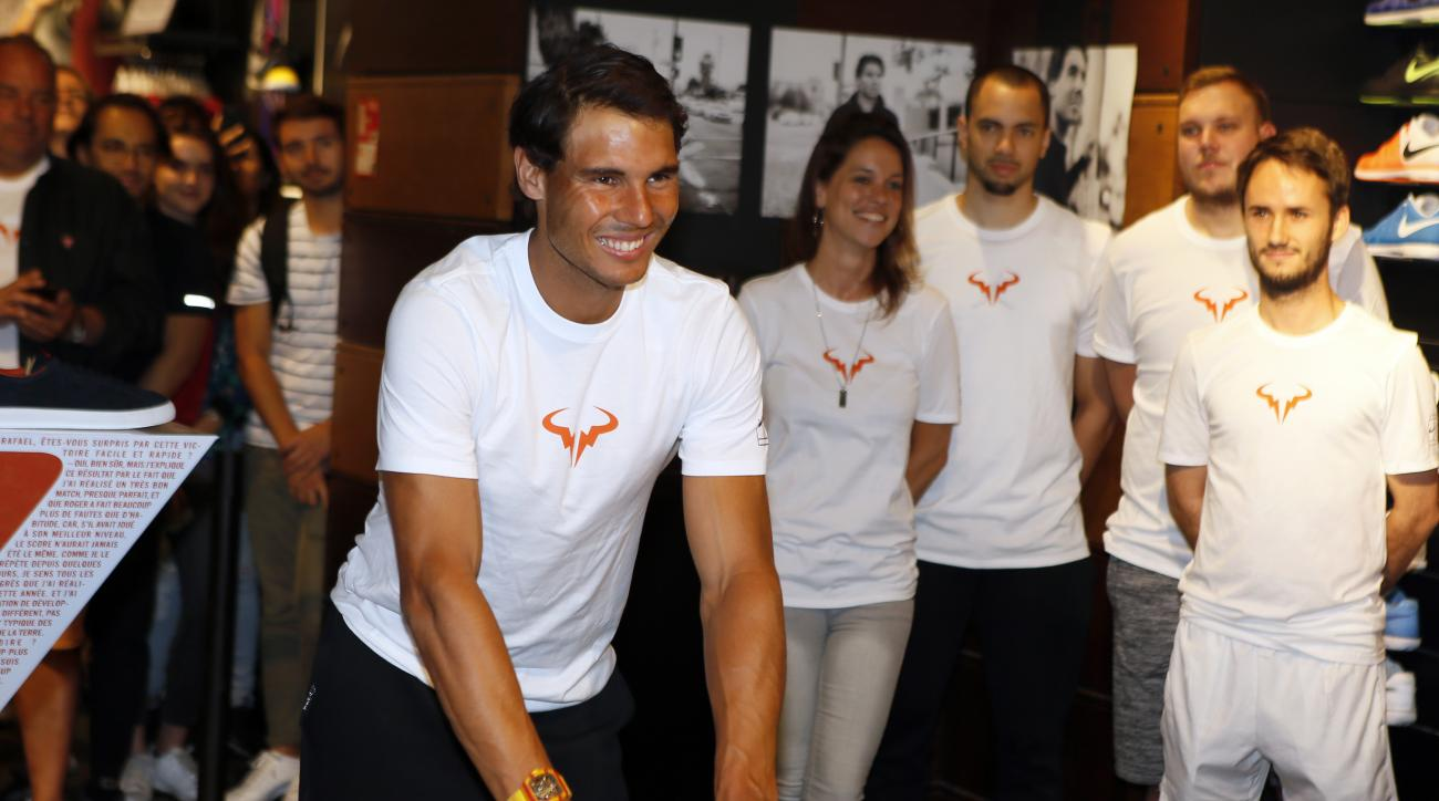 Spain's Rafael Nadal smiles during a handprints event on the Champs Elysees avenue in Paris, France, Monday, June 12, 2017. Nadal defeated Switzerland's Stan Wawrinka in the men's final at the French Open tennis championships on Sunday. (AP Photo/Francois