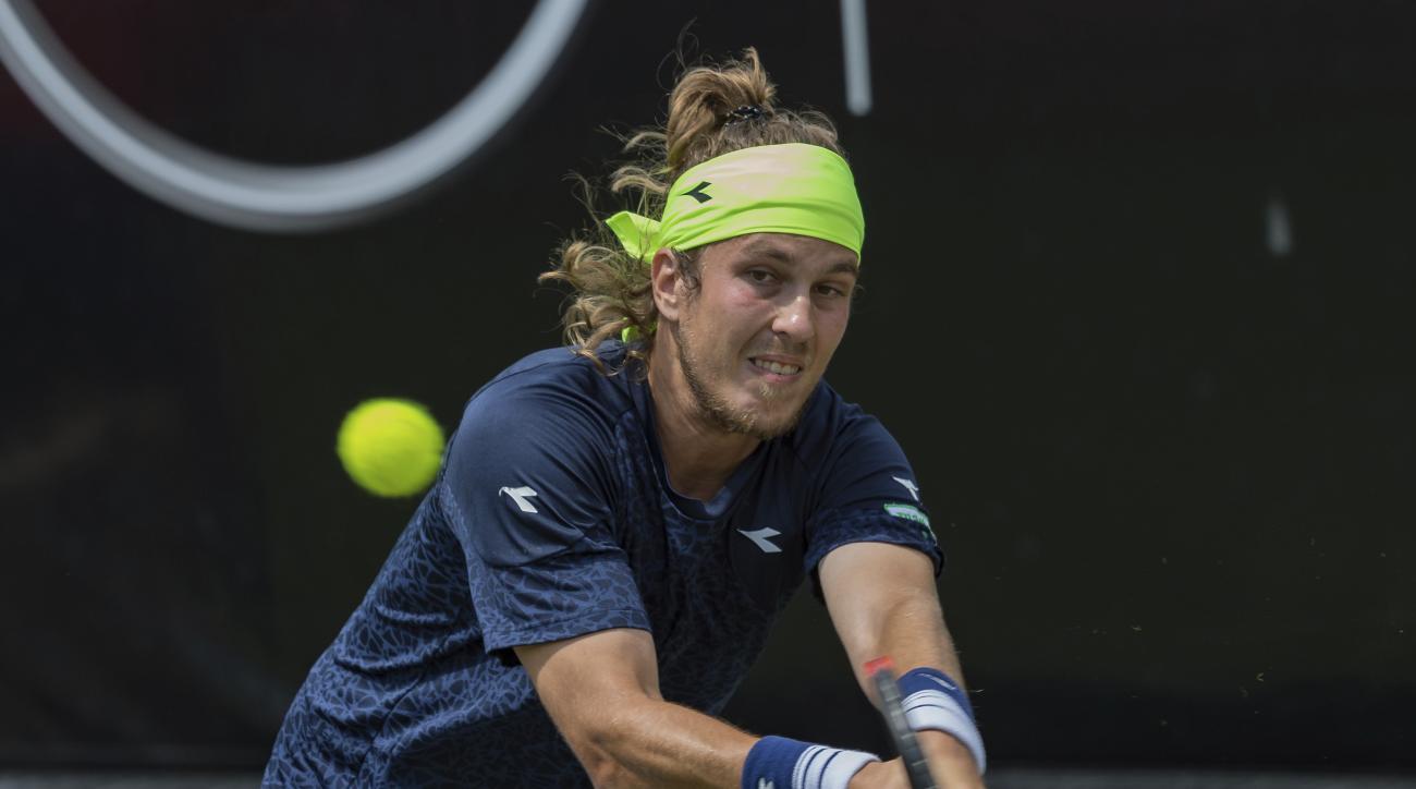 Slovakia's Lukas Lacko  returns a shot to Germany's Jan-Lennard Struff at the Mercedes Cup ATP tennis tournament in Stuttgart, Germany, Monday, June 12, 2017. (Daniel Maurer/dpa via AP)