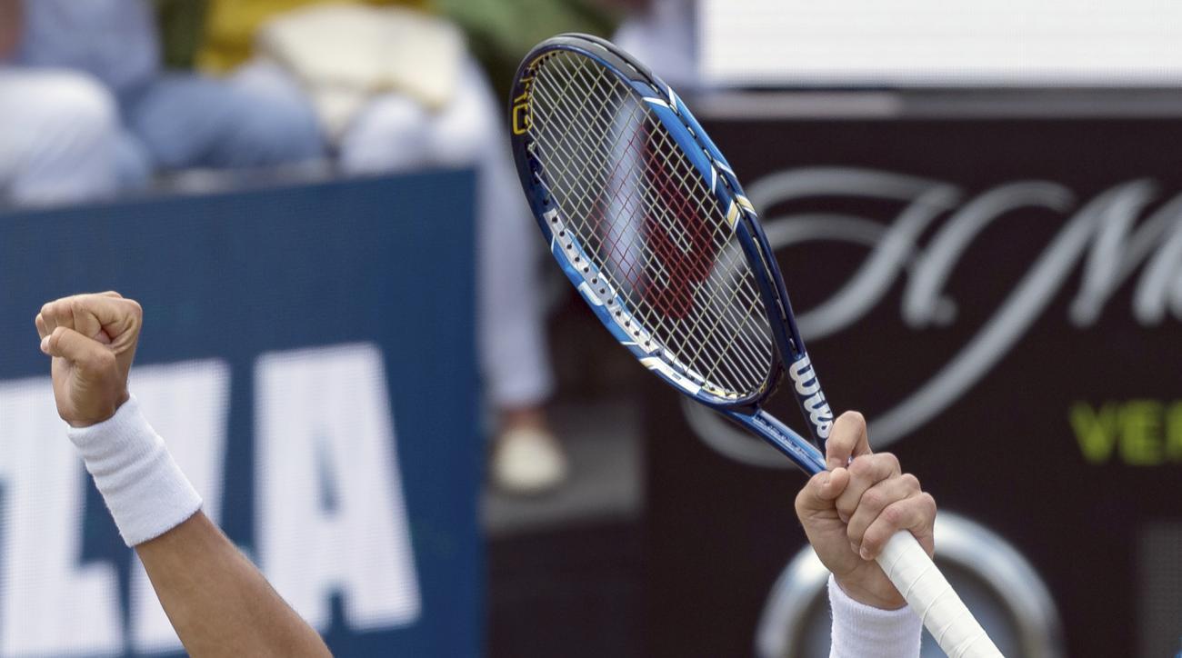 Spain's Feliciano Lopez celebrates during his semi final match against Mischa Zverev at the ATP tennis tournament in Stuttgart, Germany, Saturday, June 17, 2017. (Daniel Maurer/dpa via AP)