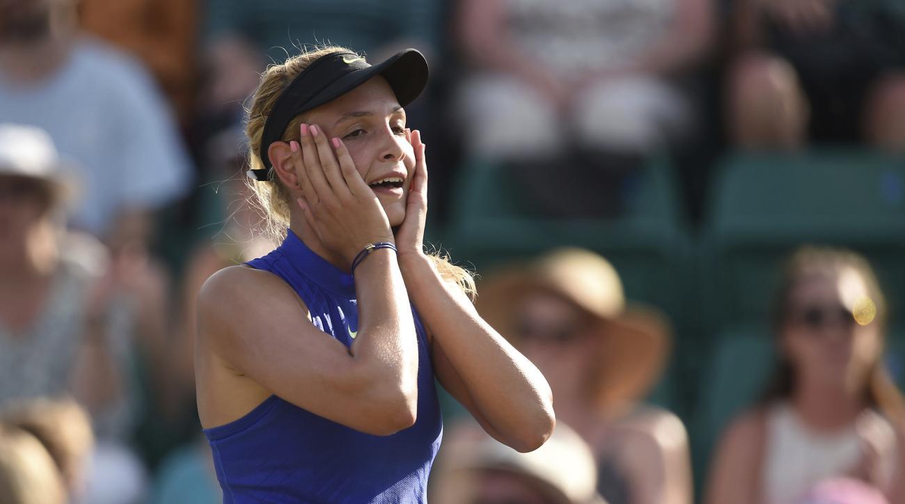 Croatia's Donna Vekic celebrates winning the women's final on day seven of the Nottingham Open at Nottingham Tennis Centre, England, Sunday June 18, 2017.  Vekic, defeated Britain's Johanna Konta 2-6, 7-6 (3), 7-5. ( Joe Giddens/PA via AP)