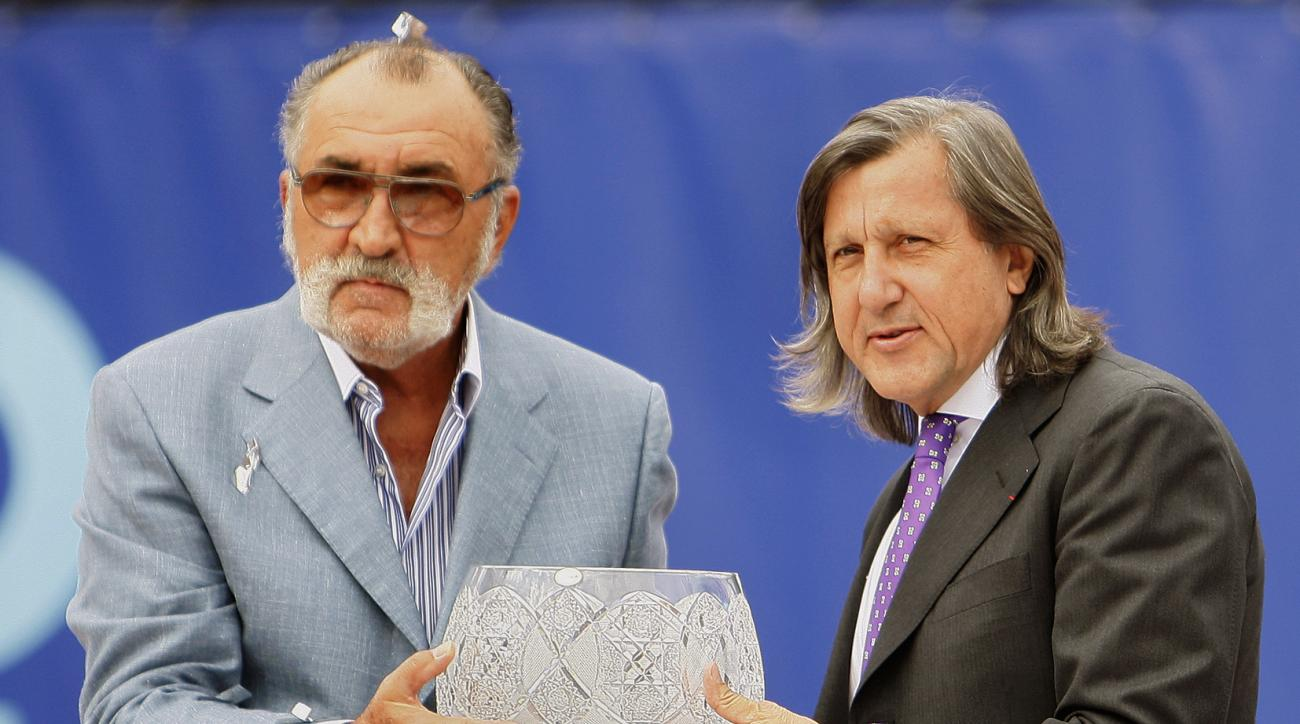 FILE - In this Sept. 27, 2009, file photo, former Romanian tennis stars Ion Tiriac, left, and Ilie Nastase pose with the trophy of the BCR Tennis Open tournament in Bucharest, Romania. Madrid Open organizer Ion Tiriac said Tuesday, June 20, 2017, he won't