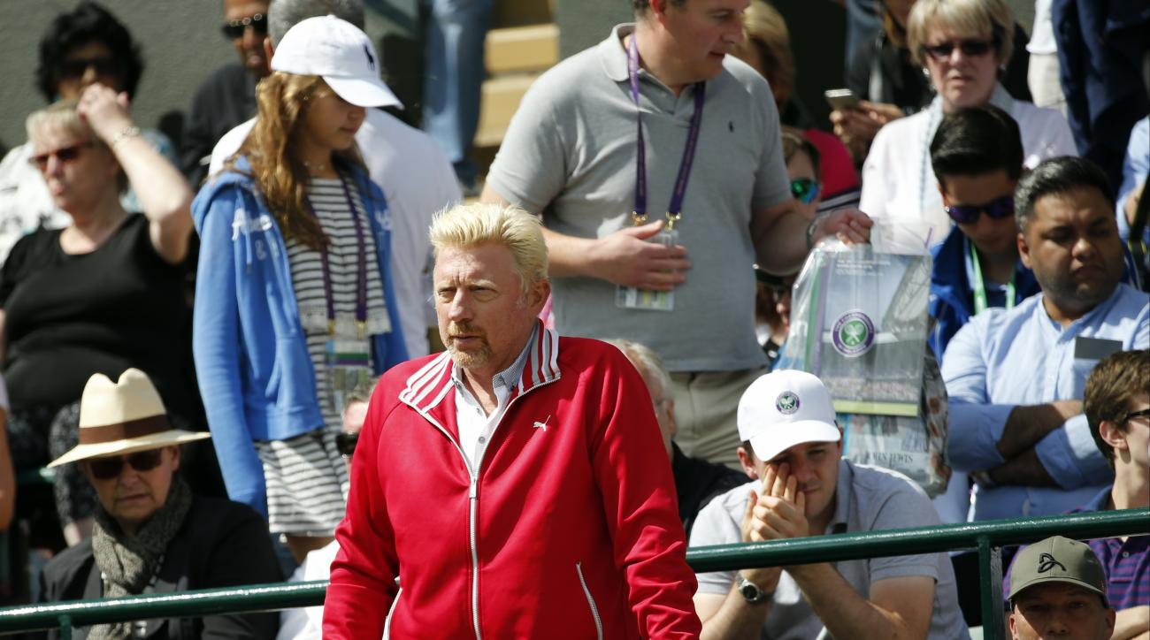 Novak Djokovic of Serbia's coach Boris Becker watches him play his men's singles match against Sam Querrey of the U.S on day six of the Wimbledon Tennis Championships in London, Saturday, July 2, 2016. (AP Photo/Alastair Grant)