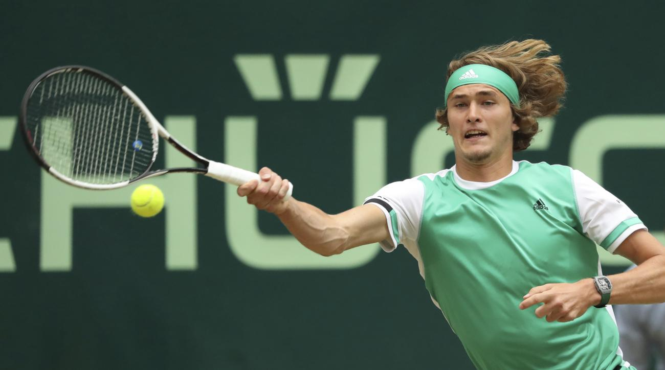 Germany's Alexander Zverev returns a shot to Switzerland's Roger Federer during the final match of the Gerry Weber Open tennis tournament in Halle, Germany, Sunday, June 25, 2017.  (Friso Gentsch/dpa via AP)