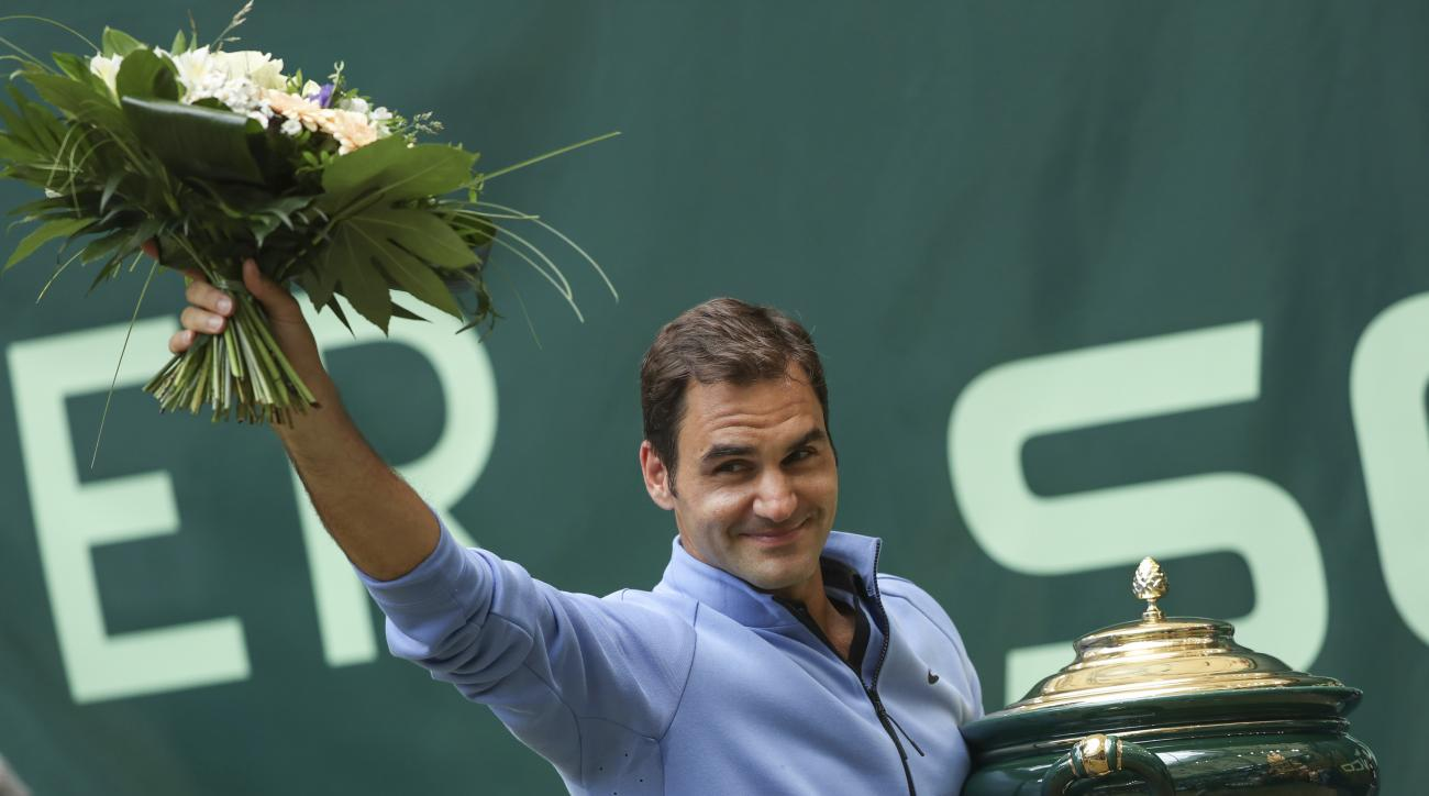 Switzerland's  Roger Federer celebrates his victory after the final match against  Germany's Alexander Zverev at the Gerry Weber Open tennis tournament in Halle, Germany, Sunday, June 25, 2017.  Roger Federer defeated Germany's Alexander Zverev in two set