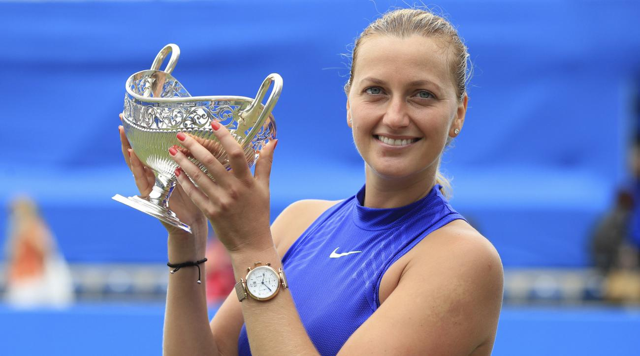 Czech Republic's Petra Kvitova celebrates with the trophy after winning the final match at the Birmingham Classic tennis tournament against  Australia's Ashleigh Barty at Edgbaston Priory, Birmingham, England, Sunday June 25, 2017. (Mike Egerton/PA via AP