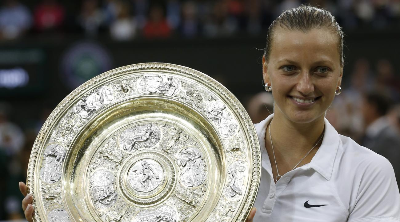 FILE - In this July 5, 2014, file photo, Petra Kvitova, of Czech Republic, holds the trophy after winning the women's singles final against Eugenie Bouchard at the All England Lawn Tennis Championships in Wimbledon, London. Kvitova still has not regained