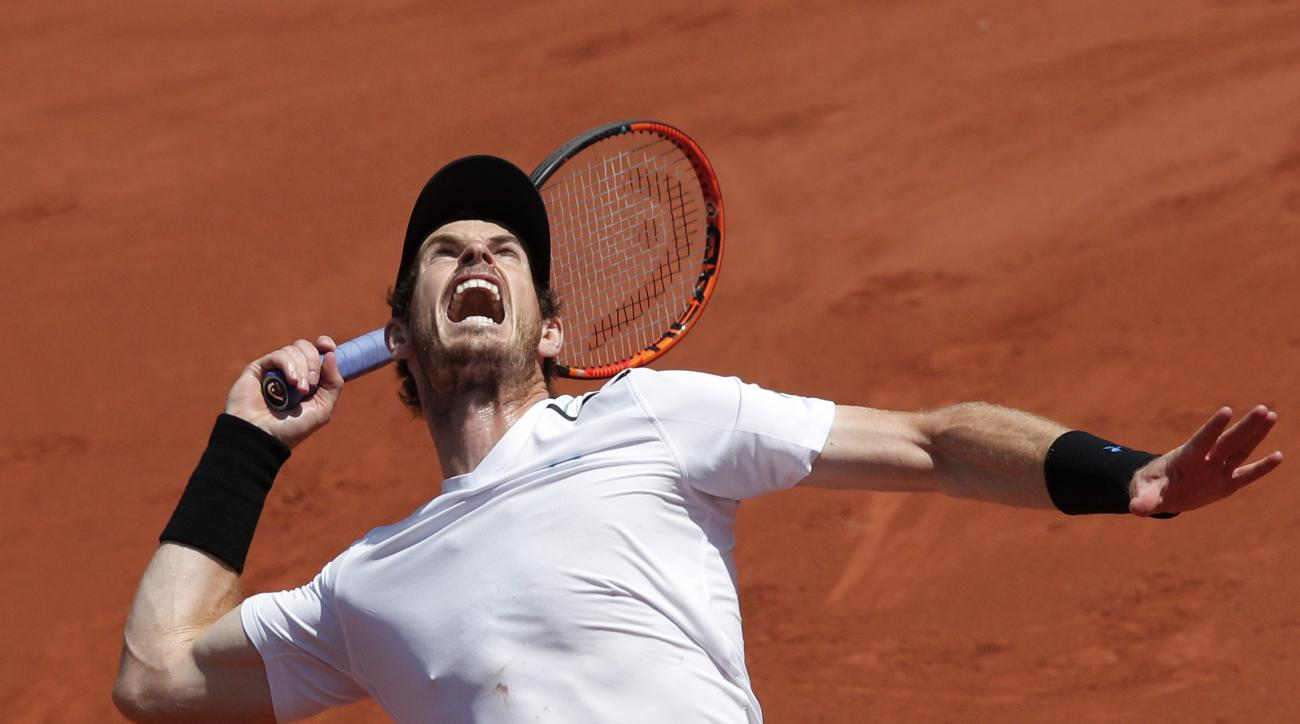 FILE - In this June 9, 2017, file photo, Britain's Andy Murray serves against Switzerland's Stan Wawrinka during their semifinal match of the French Open tennis tournament at Roland Garros stadium, in Paris. Murray's comfort level and crowd support at Wim