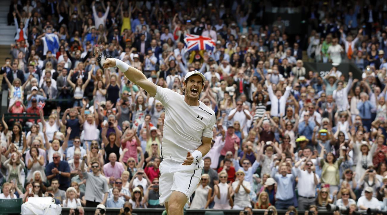 FILE - In this July 10, 2016, file photo, Andy Murray, of Britain, celebrates after beating Milos Raonic, of Canada, in the men's singles final at the Wimbledon Tennis Championships in London. Play at Wimbledon begins Monday, July 3. (AP Photo/Kirsty Wigg