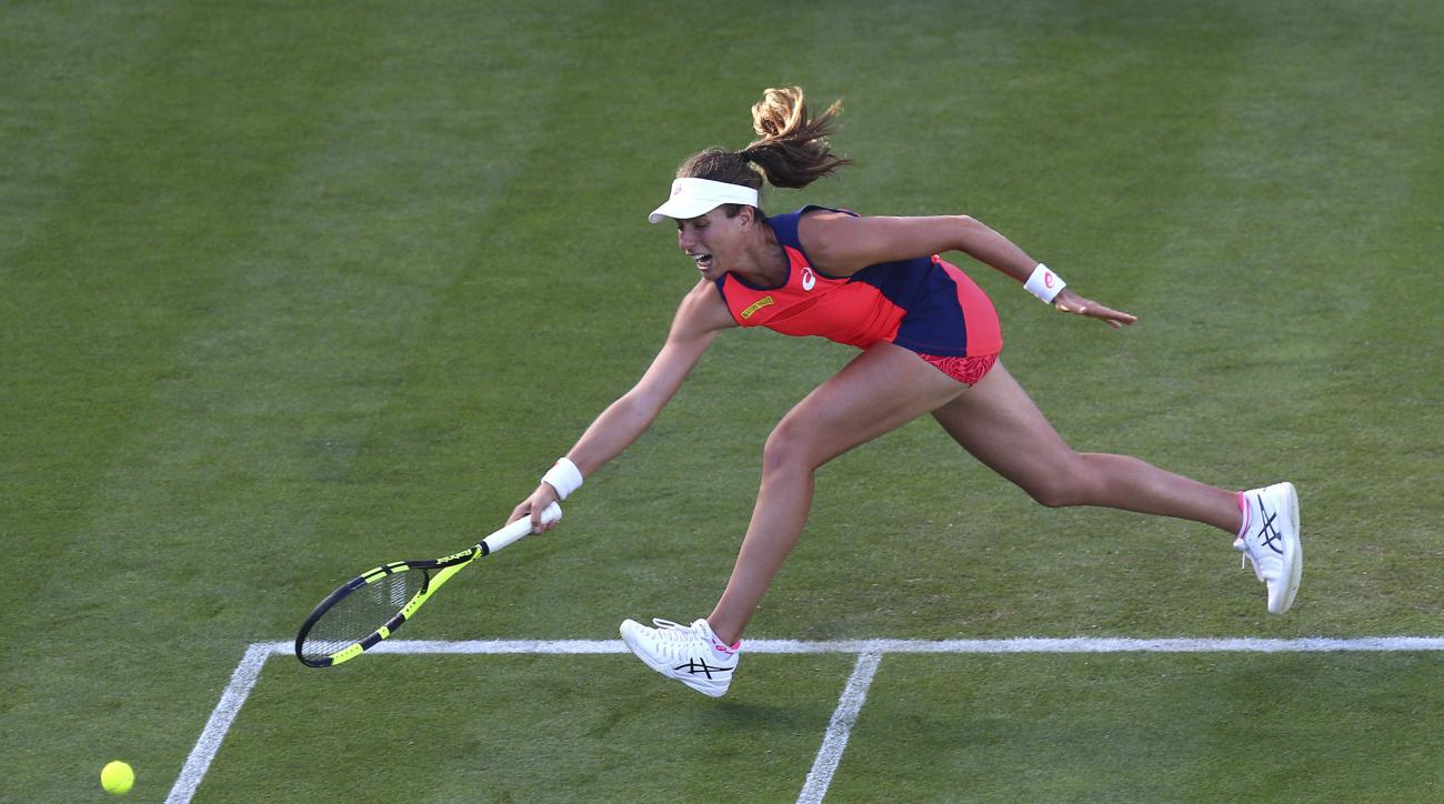 Germany's Angelique Kerber in action against Great Britain's Johanna Konta during day seven of the International tennis at Devonshire Park, Eastbourne, southern England, Thursday June 29, 2017. (Gareth Fuller/PA via AP)