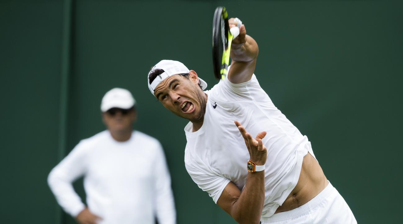 Rafael Nadal of Spain serves during a training session at the All England Lawn Tennis Championships in Wimbledon, London, Saturday, July 1, 2017. The  (Peter Klaunzer/Keystone via AP)