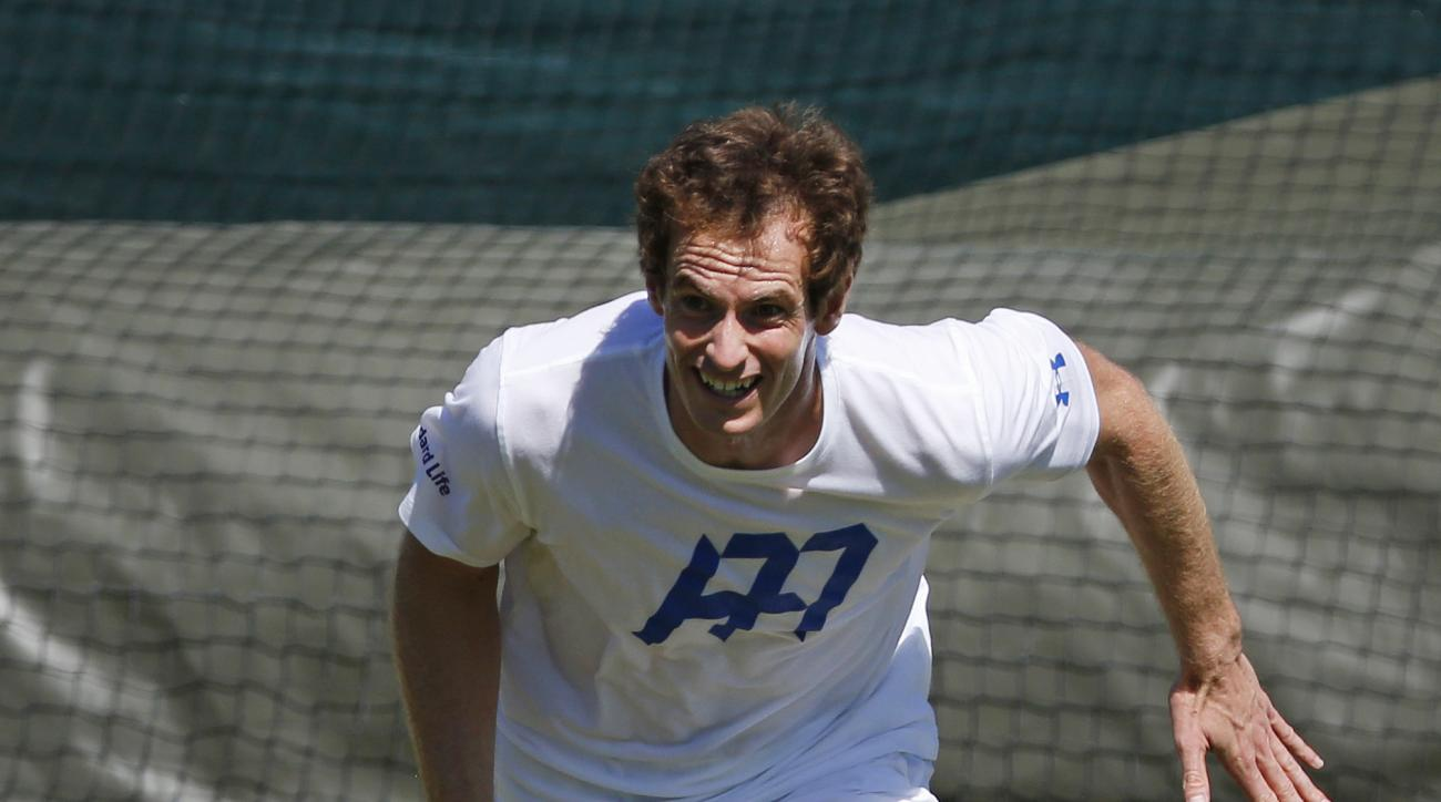 Britain's Andy Murray grimaces as he runs for the ball during a practice session ahead of the Wimbledon Tennis Championships in London, Sunday, July 2, 2017. (AP Photo/Alastair Grant)