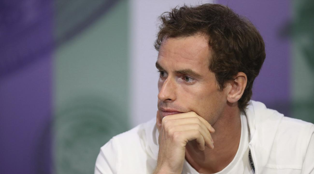 Britain's Andy Murray gives a press conference ahead of the Wimbledon Tennis Championship at The All England Lawn Tennis Club in London, Sunday, July 2, 2017. (Jed Leicester/Pool Photo via AP)