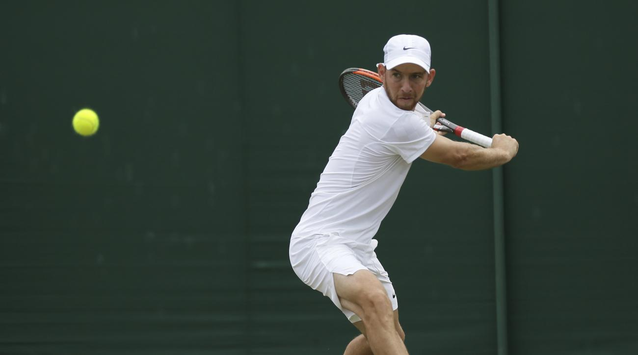 Israel's Dudi Sela plays a return during his Men's Singles Match against John Isner of the United States on day four at the Wimbledon Tennis Championships in London Thursday, July 6, 2017. (AP Photo/Tim Ireland)